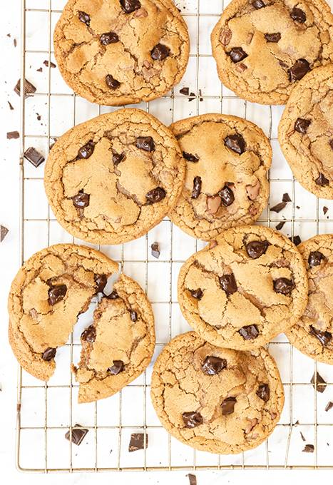 Chocolate chip cookies laid out on a wire cooling rack