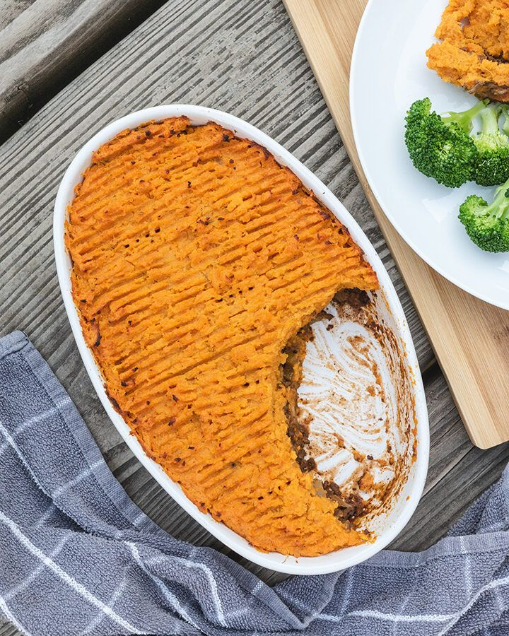 Top down view of a large oven dish containing sweet potato cottage pie