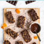 Pinterest pin graphic with text and a photo of apricot flapjacks