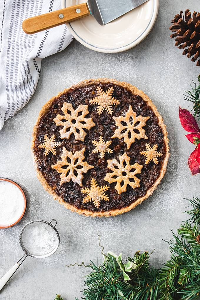 Top down view of a Christmas mincemeat tart, decorated with pastry snowflakes.
