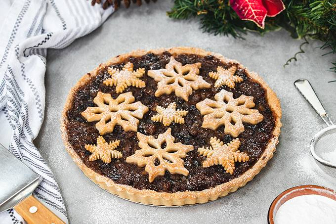 A Christmas mincemeat tart, decorated with pastry snowflakes.