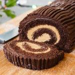 Close up of a Christmas chocolate yule log with one slice cut off