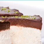 Pinterest pin graphic with text and a photo of a dairy free lime and chocolate cheesecake