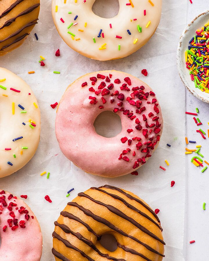 Top down view of various decorated gluten free doughnuts