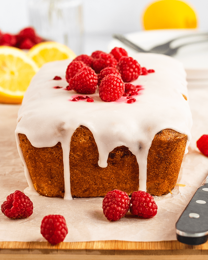 Close up of a lemon and raspberry drizzle cake.